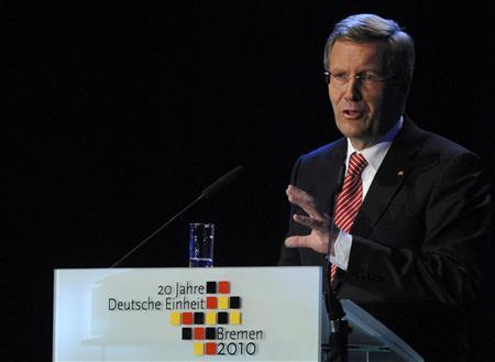 German President Christian Wulff makes an official speech during celebrations marking the country's 20th anniversary of reunification, at the Arena in Bremen October 3, 2010. REUTERS/Morris Mac Matzen