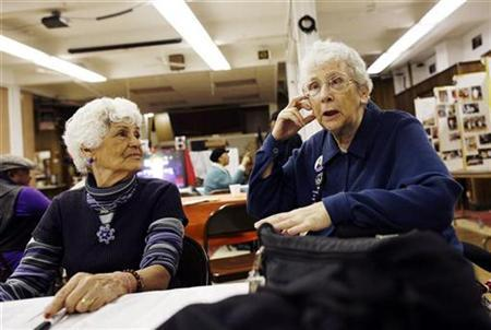 Katharine Roberts (R), 82, and Nelly Falcon, 77, sit at the Canaan Senior Service Center in New York February 10, 2009. REUTERS/Shannon Stapleton