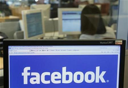 The Facebook logo displayed on a computer screen in a file photo. REUTERS/Thierry Roge