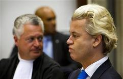 <p>Right-wing Dutch MP Geert Wilders (R) appears in court with his lawyer Bram Moszkowicz (L) in Amsterdam October 4, 2010. REUTERS/Marcel Antonisse/Pool</p>