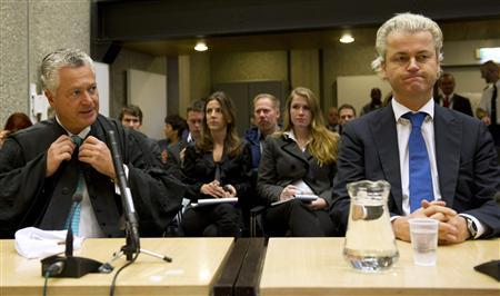 Dutch anti-Islam politician Geert Wilders sits in court alongside his lawyer Mr. Bram Moszkowicz in Amsterdam October 6, 2010. REUTERS/Marcel Antonisse/Pool