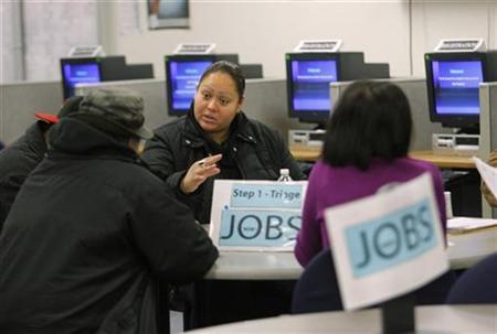 Case worker Jessica Yon discusses job eligibility for unemployed people at a jobs center in San Francisco, February 4, 2010. REUTERS/Robert Galbraith/Files