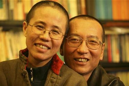 Chinese dissident Liu Xiaobo and his wife Liu Xia pose in this undated photo released by his family on October 3, 2010. REUTERS/Handout