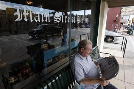 Don Olson reads the paper outside of Main Street Station store along Main Street in Grapevine, Texas October 9, 2008. REUTERS/Jessica Rinaldi