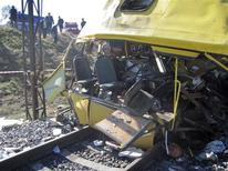 <p>The wreckage of a bus is seen after a collision with a goods train in Ukraine's Dnipropetrovsk region October 12, 2010. REUTERS/Pool</p>
