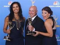 <p>Padma Lakshmi, Tom Collichio and Gail Simmons (L to R), winners for outstanding reality competition program for 'Top Chef,' pose backstage at the 62nd annual Primetime Emmy Awards in Los Angeles, California, August 29, 2010. REUTERS/Danny Moloshok</p>