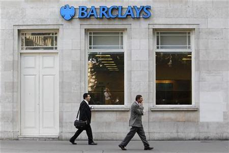 Pedestrians walk past a Barclays bank in London August 5, 2010. REUTERS/Suzanne Plunkett