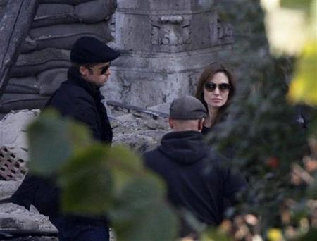 Brad Pitt (L) and Angelina Jolie are pictured in the set during the filming of her first movie ''Untitled Bosnian War Love Story'' in central Budapest October 13, 2010. REUTERS/Bernadett Szabo