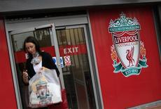 <p>A woman exits the club shop at Liverpool football club in Liverpool, October 14, 2010. REUTERS/Darren Staples</p>