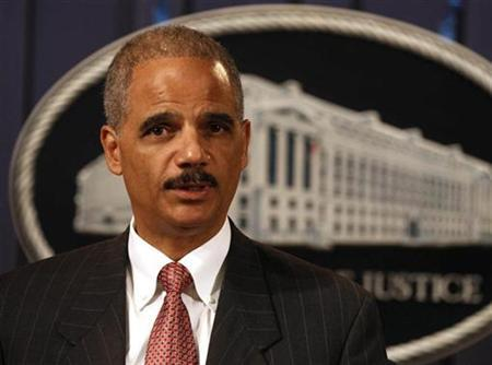 U.S. Attorney General Eric Holder discusses an antitrust issue against credit card companies at the U.S. Justice Department in Washington, October 4, 2010. REUTERS/Larry Downing