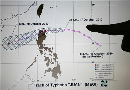 A monitor shows the track of Typhoon Megi, locally known as Juan, at the Philippine Atmospheric, Geophysical and Astronomical Services Administration (PAGASA) in Manila October 17, 2010. An approaching typhoon triggered warnings in 19 northern Philippines provinces with forecasters expecting it to intensify to a super typhoon with winds in excess of 250 kph (155 mph) as it makes landfall on Monday. REUTERS/Cheryl Ravelo