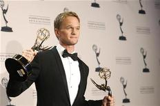 <p>Actor Neil Patrick Harris holds his Emmy awards for Outstanding Guest Actor in a Comedy Series and Outstanding Special Class Programs at the Primetime Creative Arts Emmy Awards in Los Angeles August 21, 2010. REUTERS/Mario Anzuoni</p>