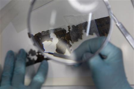 A preservationist works on a fragment of the Dead Sea Scrolls in a laboratory in the Israel Museum in Jerusalem October 18, 2010. REUTERS/Baz Ratner