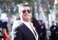 """<p>Simon Cowell na última temporada de 'American Idol' em Los Angeles. Cowell assinou um acordo com a ITV que manterá o astro dos programas de reality show """"X Factor"""" e """"Britain's Got Talent"""" no canal até 2013, informou a emissora britânica. 26/05/2010 REUTERS/Mario Anzuoni</p>"""
