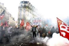 "<p>A man holds a placard which reads ""Listen to the public's rage"" during a demonstration in front of the French Senate in Paris October 20, 2010. REUTERS/Charles Platiau</p>"
