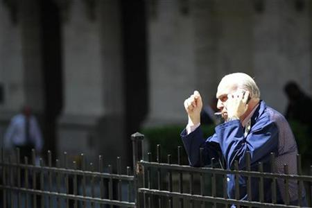 A stock trader smokes a cigarette outside the New York Stock Exchange, May 20, 2010. REUTERS/Brendan McDermid