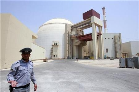 EDITORS' NOTE: Reuters and other foreign media are subject to Iranian restrictions on leaving the office to report, film or take pictures in Tehran. A security official talks to journalists in front of Bushehr main nuclear reactor, 1,200 km (746 miles) south of Tehran, August 21, 2010. REUTERS/Raheb Homavandi