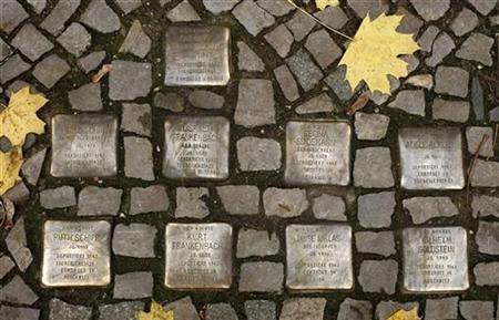 So-called ''Stolpersteine'' (stumbling blocks), memorial pavement plaques commemorating German Jews who died in the concentration camps of Auschwitz and Theresienstadt, are pictured in Berlin's Wilmersdorf district November 7, 2008. REUTERS/Fabrizio Bensch