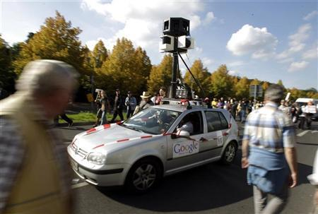 Demonstrators drive a car decorated to represent the Google Car used to create street view maps during a demonstration for data privacy in Berlin, September 11, 2010. REUTERS/Tobias Schwarz