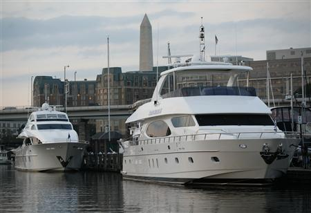 Private motor yachts are docked at Gangplank Marina in Washington DC, October 19, 2010. REUTERS/Molly Riley