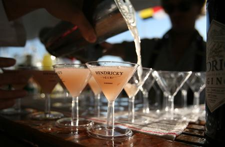 A bartender pours martinis on a yacht at the United States Sailboat Show in Annapolis, October 9, 2010. REUTERS/Molly Riley