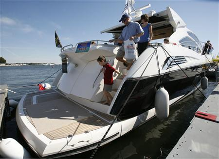 Visitors tour a motor yacht for sale at the United States Powerboat Show in Annapolis, October 17, 2010. REUTERS/Molly Riley