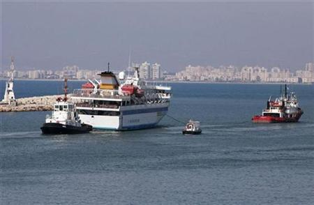 The cruise liner Mavi Marmara (2nd L) is towed by a Turkish tugboat (R) as it leaves the port of the northern city of Haifa August 5, 2010. REUTERS/Max Yelinson/Maariv