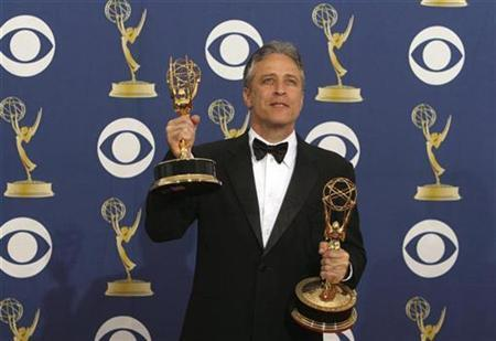 Jon Stewart holds the awards he won for best writing for a variety, musical or comedy show and for best variety, music or comedy series for ''The Daily Show with Jon Stewart'' at the 61st annual Primetime Emmy Awards in Los Angeles, California September 20, 2009. REUTERS/Lucy Nicholson