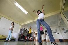 <p>Members of the Tiger Girls (L-R) Baby Tiger, Tricky Tiger, Electro Tiger and Missy Tiger rehearse for their upcoming live concert in their studio at Yangon September 17, 2010. REUTERS/Soe Zeya Tun</p>