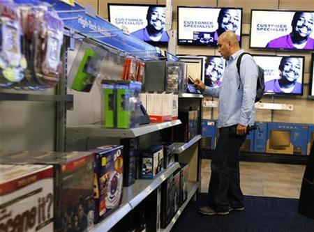 A man shops for electronics at a Best Buy store in New York May 18, 2010. REUTERS/Shannon Stapleton