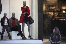 <p>An Iranian woman looks on as she stands next to a Benetton shop window in northern Tehran October 24, 2010. REUTERS/Morteza Nikoubazl</p>