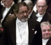 <p>Visibly emotional writer Sir V.S. Naipaul waits to receive his Nobel prize for literature at Stockholm's Konserthuset from Sweden's King Carl Gustaf December 10, 2001. REUTERS/Chris Helgren</p>