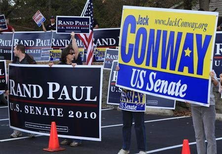 Campaign supporters and volunteers cheer for their candidates before the last of four debates between Democratic U.S. Senate candidate Jack Conway and Republican U.S. Senate candidate Rand Paul at the Kentucky Education Television network headquarters in Lexington, Kentucky October 25, 2010. REUTERS/John Sommers II