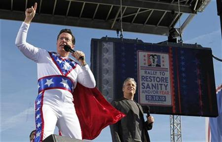 Comedian Stephen Colbert (L) addresses the crowd in front of fellow rally host Jon Stewart during their ''Rally to Restore Sanity and/or Fear'' on the National Mall in Washington, October 30, 2010. REUTERS/Jim Bourg