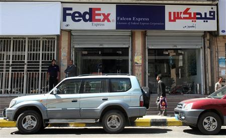 A man walks past the Yemen office of the FedEx company in Sanaa October 30, 2010. REUTERS/Khaled Abdullah