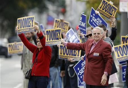Supporters of Pennsylvania Republican senatorial candidate Pat Toomey and Democratic Senatorial candidate Congressman Joe Sestak hold signs on the street before a debate at the National Constitution Center in Philadelphia, Pennsylvania, October 20, 2010. REUTERS/Tim Shaffer