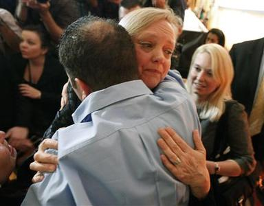 California Republican gubernatorial candidate Meg Whitman hugs a supporter after giving her concession speech during her election night rally in Los Angeles, California, November 2, 2010. REUTERS/David McNew
