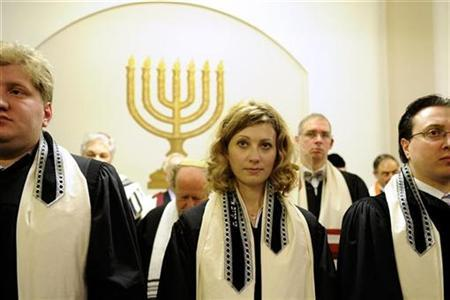 Rabbi Alina Treiger (2ndL) stands amongst male colleagues during her ordination the Pestalozzi strasse Synagogue in Berlin November 4, 2010. REUTERS/Odd Andersen/Pool
