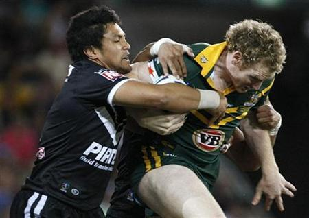 Australia's Joel Monaghan (R) is tackled by New Zealand's Jerome Ropati during the Rugby League World Cup final in Brisbane November 22, 2008. REUTERS/Mick Tsikas