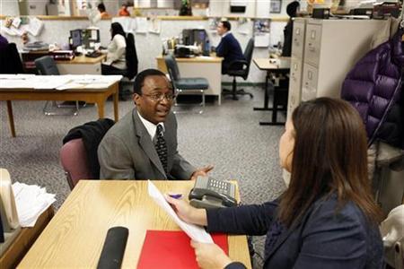 AmeriChoice recruiter Selene Valdez (R) interviews a job seeker at a New York State Department of Labor recruitment office in New York January 6, 2010. REUTERS/Lucas Jackson