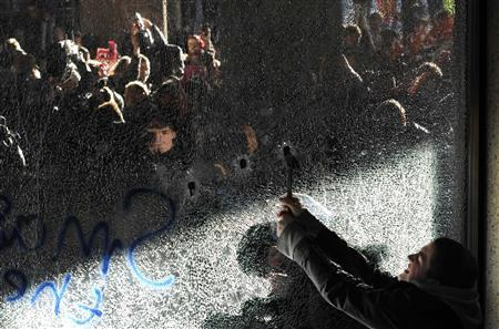 Demonstrators break windows of the Conservative Party headquarters building during a protest in central London November 10, 2010. REUTERS/Paul Hackett