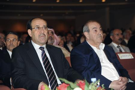 Iraq's Prime Minister Nuri al-Maliki (L) and former Iraqi premier and head of the secular Iraqiya coalition, Iyad Allawi are seen at a parliament session in Baghdad, November 11, 2010. REUTERS/Stringer