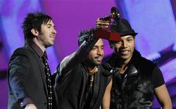 "<p>Members of Camila hold their award for Best Pop Album by a Duo or Group for ""Dejarte de amar"" at the 11th annual Latin Grammy Awards in Las Vegas, Nevada November 11, 2010. REUTERS/Mario Anzuoni</p>"