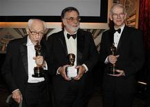 <p>Actor Eli Wallach, (L) director Francis Ford Coppola and filmmaker and film historian Kevin Brownlow (R) pose after The Governors Awards held by the Academy of Motion Picture Arts & Sciences in Hollywood, California November 13, 2010. REUTERS/Fred Prouser</p>
