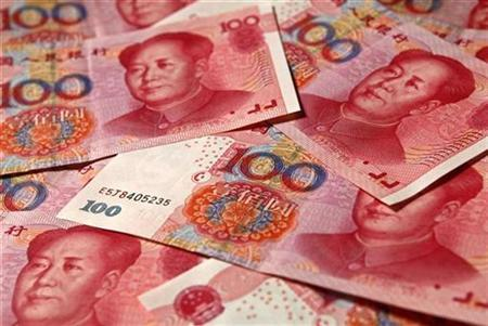 Yuan banknotes are seen in this picture illustration taken in Beijing November 1, 2010. REUTERS/Petar Kujundzic