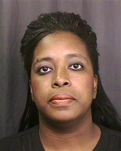 Energy trader Stephanie Roqumore is seen in a 1999 Harris County Sheriff's Department mugshot photo from a case unrelated to the September 2010 federal indictment for wire fraud and money laundering. REUTERS/Harris County Sheriff's Office/Handout