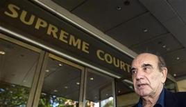 <p>British author Alan Shadrake arrives at the Supreme Court in Singapore November 3, 2010. REUTERS/Vivek Prakash</p>