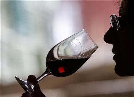 A wine selector tastes red wine from the latest vintage at Bonini winery's wine-cellar in the village of Brestovitsa, about 150km (93miles) east of the capital Sofia, in this December 8, 2009 file photo. REUTERS/Oleg Popov/Files