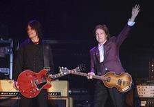 <p>Paul McCartney (R) performs during a concert in Porto Alegre November 7, 2010. REUTERS/Edison Vara</p>