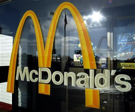 The golden arches of McDonald's is photographed at the restaurant in Moses Lake, Washington, December, 24, 2003. REUTERS/Jeff T.